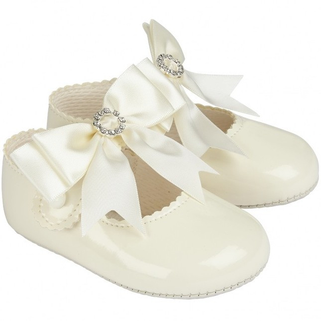 0615a0244d24 Baby Girls Ivory Large Diamante Bow Patent Pram Shoes